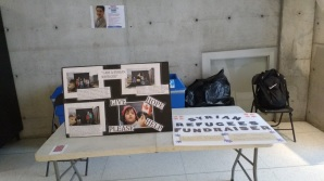 A table set up to collect clothing and raise awareness, February 29